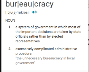 screenshot shows definition for bureaucracy and read aloud button
